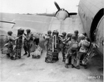 101st Airborne Division loading equipment onto a C-47 preparing for a jump